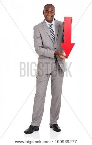 portrait of afro american businessman holding red arrow pointing down on white background