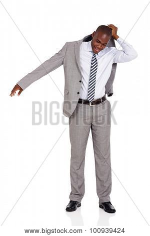 handsome african businessman putting on his suit coat