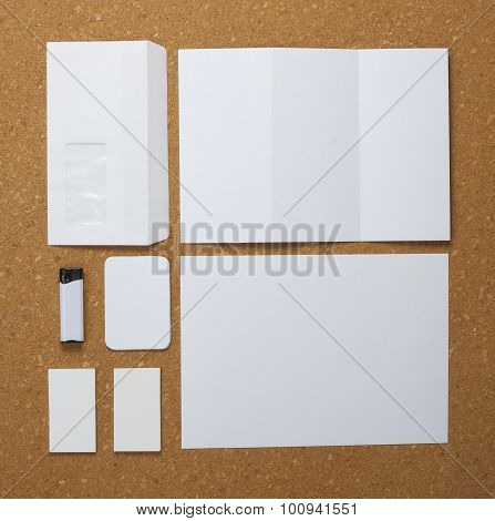 White Collection Of Stationery On Corkboard Background.