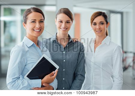 Female Business Team Using A Digital Tablet