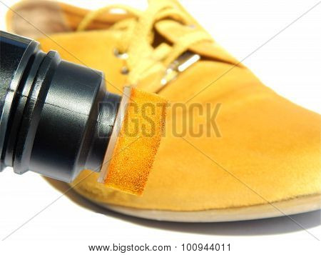 Yellow boot and yellow paint for shoes on white background