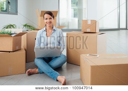 Beautiful Woman Sitting On The Floor With A Laptop