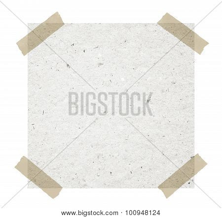 Gray recycled note paper with adhesive tape on white background