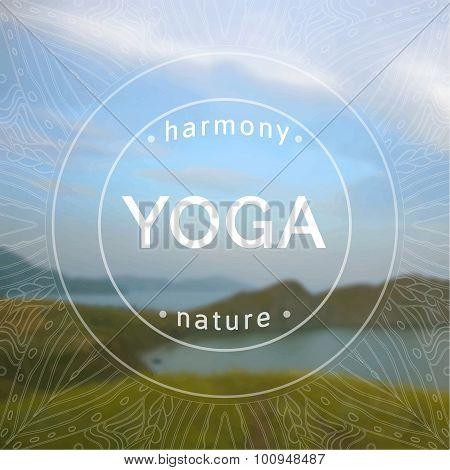 Name of yoga studio on a blurred sea background.