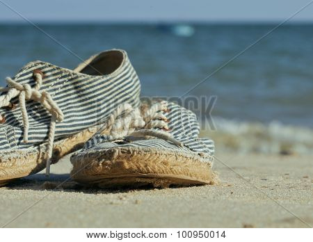 picture of vintage old shabby sneakers at seacost, real forgotte