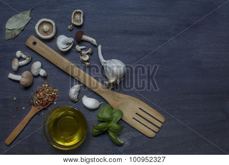 Mushrooms And Condiment On Dark Background