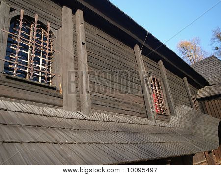 Barred Window In An Old Wooden Church