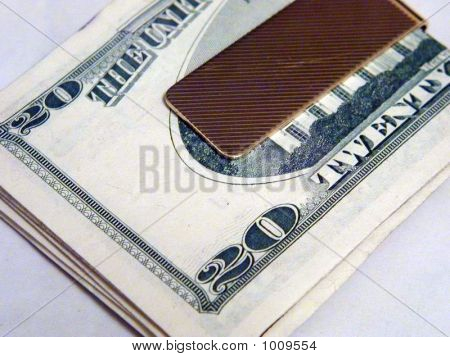 Moneyclip With A Wad Of Cash Inside Of It.