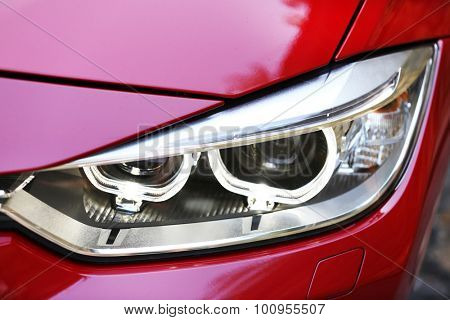 Headlights of red car