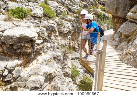 Young Couple Doing Hiking In El Caminito Del Rey, Malaga, Spain.