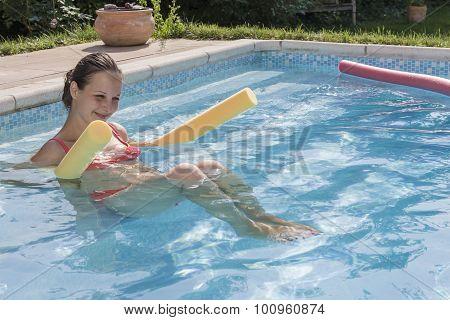 Girl Enjoying A Pool