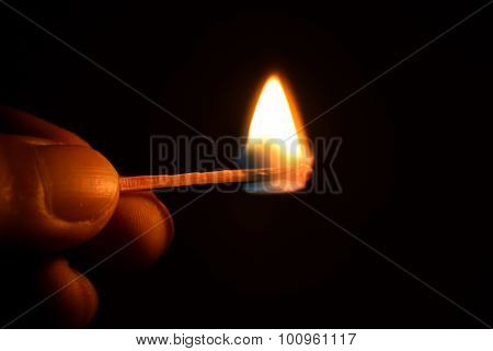 hold are ignited matches isolate on black background