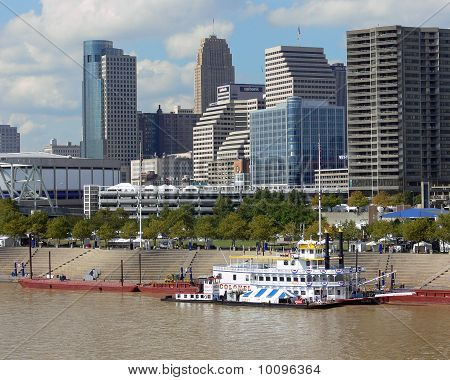 city scene with riverboat