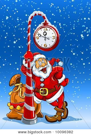 santa claus with sack of gifts under clock