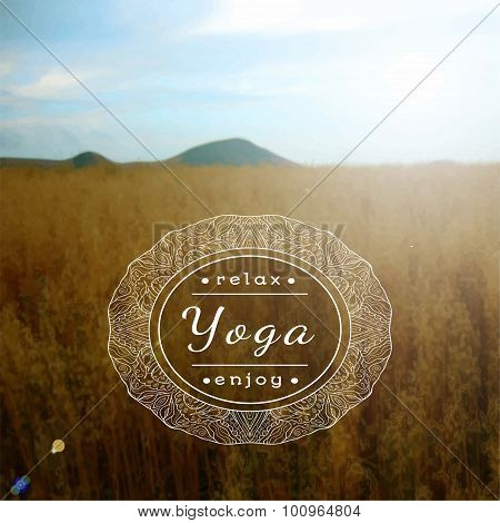 Name of yoga studio on a blurred field background.