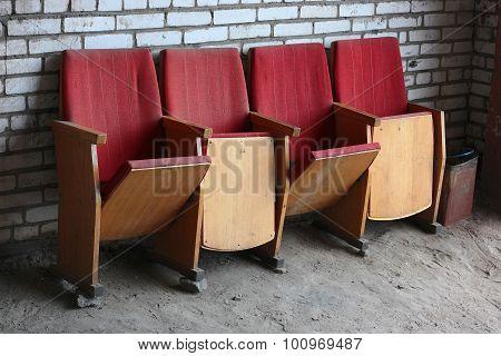 Four Folding Chairs Near Brick Wall