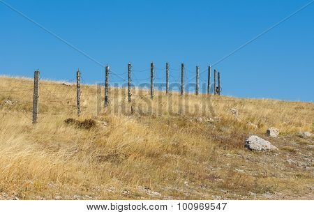 Guarded landscape - barrier with barbed wire