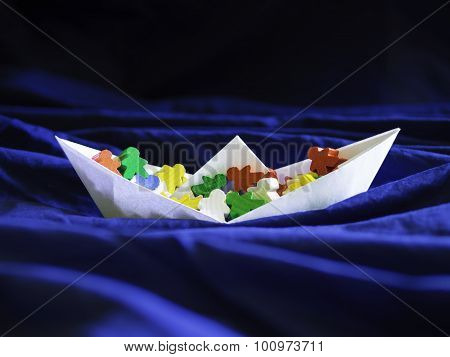 Immigration emigration migration concept, paperboat with meeples