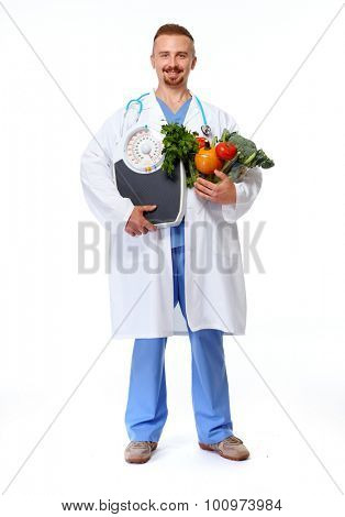 Doctor nutritionist with scales and vegetables isolated white background.