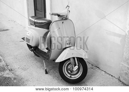 Classic Vespa Scooter Stands In A Town