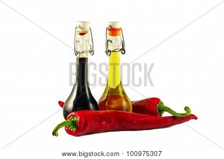 Two bottles of wine vinegar, olive oil and two red hot chilly pe