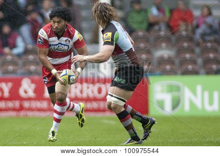 TWICKENHAM, ENGLAND. 17 SEPTEMBER 2011. Gloucester's Lesley Vainikolo, and Harlequins Mike Brown,  in action during the Aviva premiership rugby union match between Harlequins and Gloucester