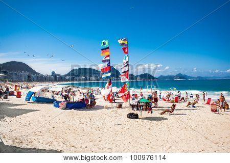 RIO DE JANEIRO, BRAZIL - APRIL 24, 2015: Flags and Brazilians on April 24, 2015 at Copacabana Beach, Rio de Janeiro. Brazil.