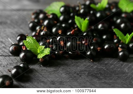 Ripe blackcurrant on wooden background