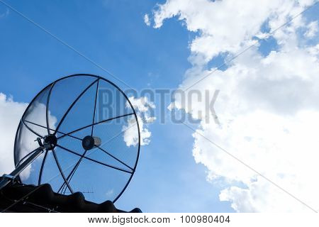 Satellite Dish On Sky And Cloud.