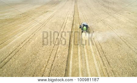 Harvester Reaps A Wheat Field