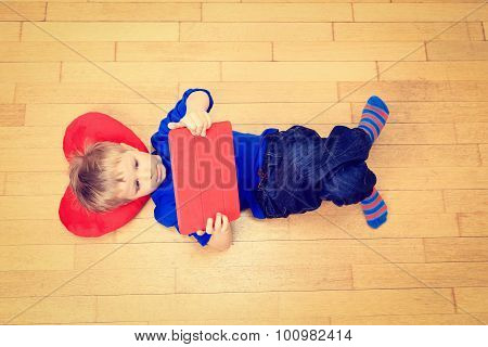 little boy looking at touch pad