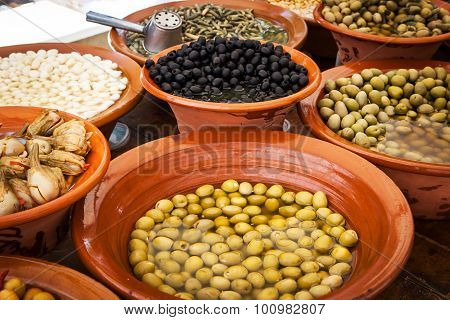Different Marinated Olives And Local Food On Spanish Street Market