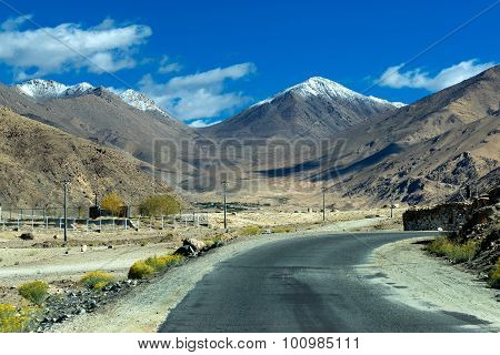 Concrete Road Towards Himalayan Mountains, Leh, Ladakh, Jammu And Kashmir, India