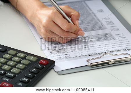 Close Up Shot Of Woman Hand Filling Tax Form