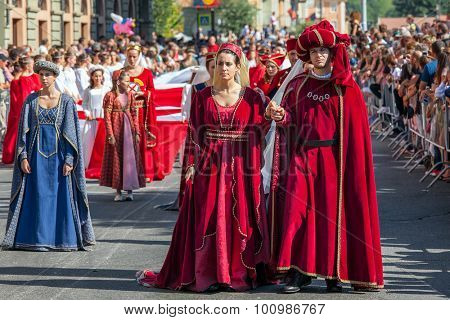 ALBA, ITALY - OCTOBER 02, 2011: Participants in historic dresses on Medieval Parade - traditional part of celebrations during annual White Truffle festival taking place each year in Alba, Italy.