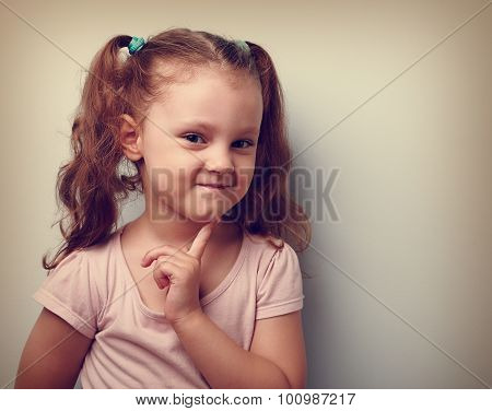 Cunning Thinking Small Kid Girl With Finger Near Face. Vintage Closeup Portrait