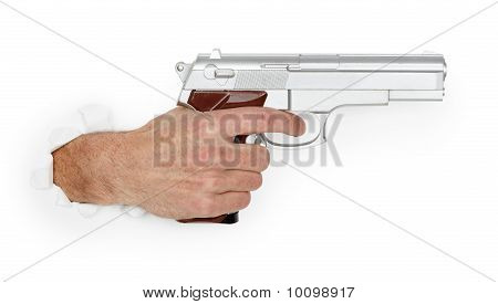 Man's Hand Holding A Large Silver Handgun