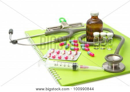 Medical Ampules, Pills And Syringes,stethoscope On Medical Chart , Isolated