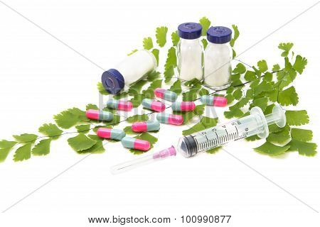Green Medical ,syringe With Medical Ampoule And Pills ,isolated