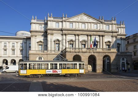 MILAN ITALY - AUGUST 29 2015: Tramway in front of Teatro alla Scala theatre in Milan Italy.