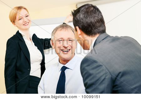 Business team discussing pleasant things