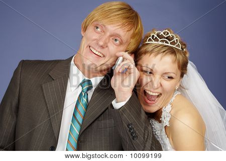 Happy Bride And Groom Is Congratulated By Phone