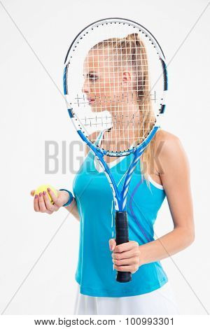 Side view portrait of a beautiful tennis player isolated on a white background