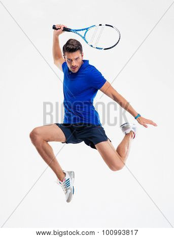 Full length portrait of a man playing in tennis isolated on a white background