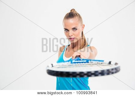 Portrait of a beautiful woman holding tennis racket standing isolated on a white background
