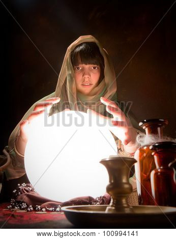 Beautiful gypsy reading the future in a crystal ball