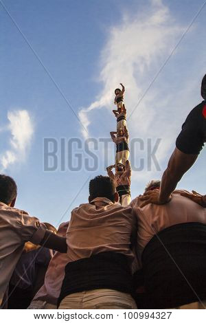 Reus, Spain - October 01, 2011: Castells Performance, a castell is a human tower built traditionally