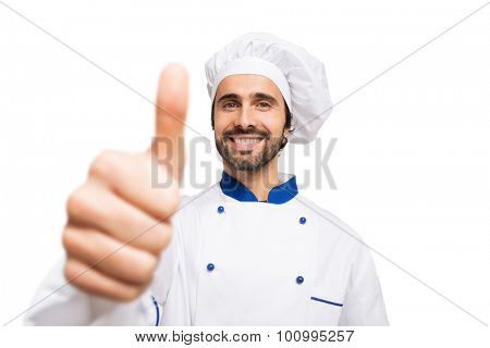 Portrait of a successful smiling chef giving thumbs up. Isolated on white