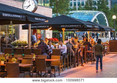 LONDON, UK - 7 SEPTEMBER, 2015: Canary Wharf night life. People sitting in local restaurant after lo