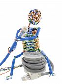 foto of utp  - The stylised little man made of a computer cable sits on spool UTP and looks on blue patch cable - JPG